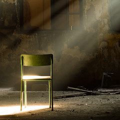A lone green chair in a dark dirty room, a ray of sunlight shines through the window on the green chair (crsan) Tags: old urban green dark square chair factory shine room dirty lone 500x500 bsquare rayofsunlight christianholmercom