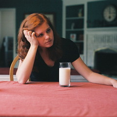 self-portrait with milk (kat.clark) Tags: red white clock film glass vintage square milk fireplace ring redhead squareformat tablecloth redhair shelves knuckles glassofmilk