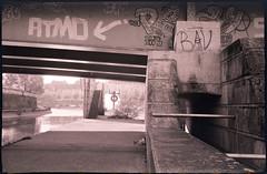 (Tricératops) Tags: street city bridge urban bw white black color film landscape lomo lomography noir symbol kodak under nb 400 pont rodinal paysage rue blanc cosmic couleur ville smena argentique urbain sous analogic c41 gomz