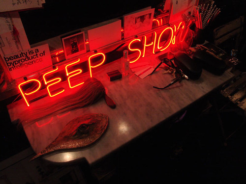 "What, you mean you don't have a neon ""peep show"" sign in your apartment?"