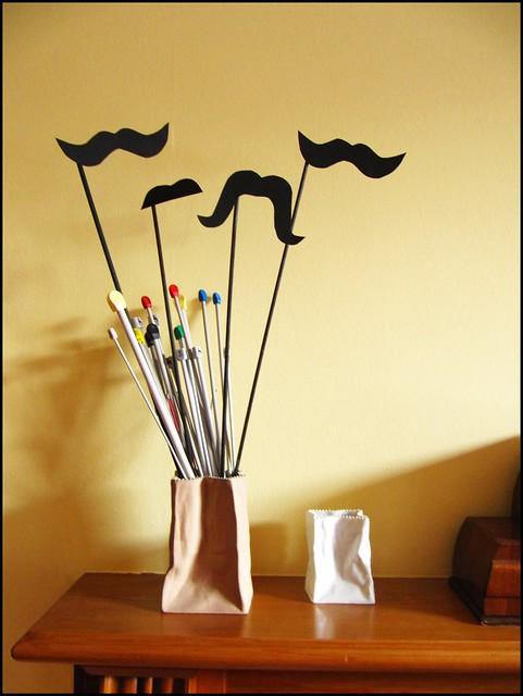 moustaches on sticks