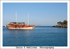 Tasucu Island Tour Boat (CTPPIX.com) Tags: trip travel blue sea vacation people mer tree canon reflections turkey island eos 350d rebel xt boat tour yacht urlaub turkiye tourists ctp deniz mavi yat 2010 turchia islandtour boattour bluevoyage meditarranean canon28135mmis tasucu icel christpehlivan ctppix goktugyatcilik