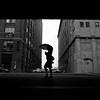 Urban Woman (Airicsson) Tags: street new york city nyc summer urban blackandwhite bw usa white ny black rain umbrella island lumix us walk manhattan panasonic symetry meatpacking 2010 streetshot lx3