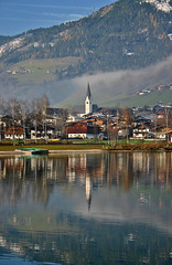 Reflections of Austria (lens buddy) Tags: bridge snow mountains alps fountain canon reflections austria sterreich lakes churches eos300d waterpark schwimmbad uttendorf eosdeurope mittershill erlebnisbadeseeuttendorf