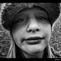 Underneath my hat! (Pjotre7 (www.maartenvandevoort.nl)) Tags: girls light shadow portrait bw sun white abstract black silly holland color colour art netherlands girl beautiful smile dutch face closeup contrast hair children nose photo blackwhite kid model eyes foc