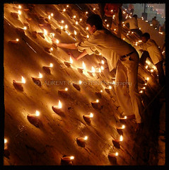 Lighting up the City (designldg) Tags: light moon india water night river square candle atmosphere celebration soul devotion varanasi hinduism kashi timeless ghats benares benaras uttarpradesh