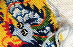 Dragon emerges under needle and yarn (Monceau) Tags: dragon needlepoint needle yarn thread canvas macro colorful relaxation macromondays 87ahobby hobby 117picturesin2017