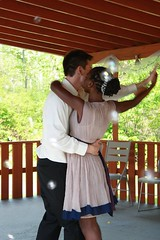 "first dance to ""Never Knew I Needed"" by Ne-Yo. The guests blew bubbles as we twirled)"