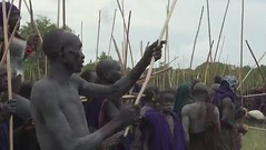 Warriors arriving for the Donga stick fighting - Ethiopia (Eric Lafforgue) Tags: men naked nude sticks artistic nu culture tribal ornament tribes blackpeople omovalley warriors bodypainting tradition tribe ethnic rite stickfighting surma tribo headdress adornment pigments headwear ethnology headgear tribu omo eastafrica donga thiopien suri etiopia ethiopie etiopa  etiopija ethnie ethiopi  etiopien etipia  etiyopya  nomadicpeople         peopleoftheomovalley peoplesoftheomovalley clip20100704132018