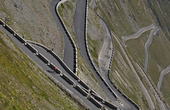 A cyclist on Stelvio (Alastair Cummins) Tags: italy mountains alps cyclist pass roads corners hairpins stelvio
