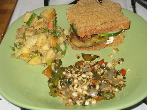 Eggplant sandwich, potato salad, corn mix