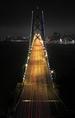 A bridge of so many faces, and I know so few (Zeb Andrews) Tags: sanfrancisco california camera city urban architecture night digital photography lights traffic action bridges baybridge markii bluemooncamera canon5dii zebandrewsphotography