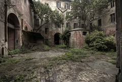 Psychiatric hospital - courtyard entry vehicles (Mr.Baldo) Tags: contributions abandonedplaces industrialarchitecture baldo industrialarcheology issue0 labandon abandoneditaly backlightmagazine mrbaldo
