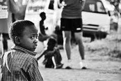 Look Back (Mijn Focus Fotografie) Tags: look back black dark people kid child children kinderen donker zwart gekleurd gekleurde getint omkijken watch see face bw white wit contraxt jongen boy kerel man human south africa 2010 zuid afrika zuidafrika southafrica footbal soccer story emotions emotie verhaal gezicht uitdrukking
