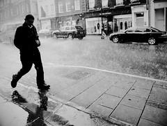 A spot of rain (Ian Brumpton) Tags: street blackandwhite bw london blancoynegro blackwhite noiretblanc candid explore londres mayfair stormyweather londonist raintown sidewalkstories explored blackwhitephotos londonstreetphotography scattidistrada blitzunddonner aspotofrain aimlessstrolling londonatlarge