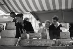 the addicts' banquet (ii) (The Cassandra Project) Tags: switzerland swiss schweiz svizzera suiza sveitsi yashicafrii vintage film fujineopan400 diafine monochrome bw sw expired 35mm kleinbild lucerne luzern festival speciesism greed addiction stall cheese market sellingdeathanddecay stench kse gestank casomorphin