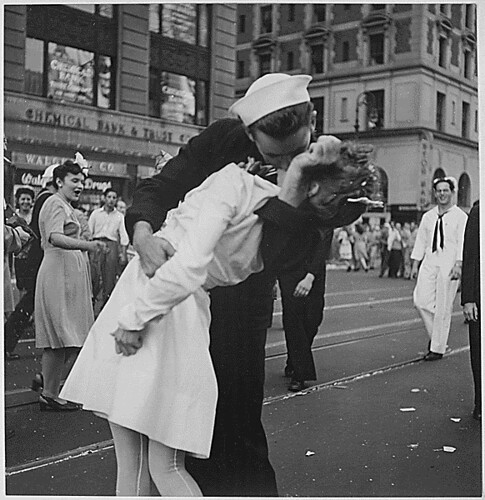 New York City celebrating the surrender of Japan. They threw anything and kissed anybody in Times Square., 08/14/1945