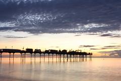 CC2186 (Chris Chapman Creative Media) Tags: autumn light sea sunlight seascape sunrise canon lens eos pier colours tripod september devon flare kit groins teignmouth velbon 1000d