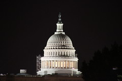The United States Capitol Alight At Night in W...