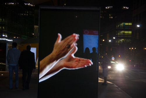 Night outside Lincoln Center with an advertisement