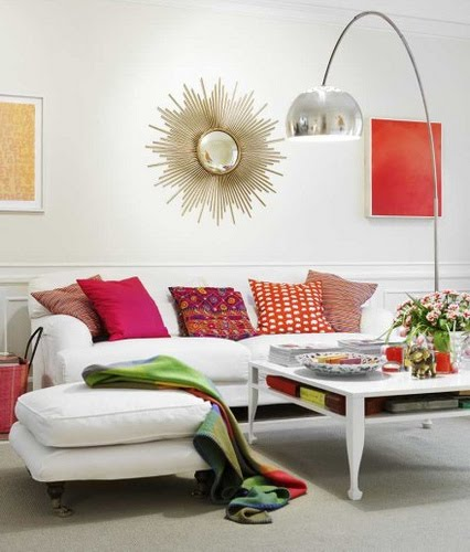 white+living+room+starburst+mirror+colorful+pillows+apt+34