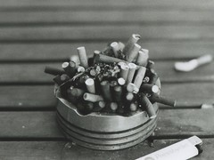 (smallcutsensations) Tags: blackandwhite iso400 f14 ashtray cigarettes ilford ilforddelta400 canonae1p silences beginnersphotography smallcutsensations