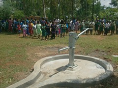 Alpha people moving towards water source during hand over ceremony