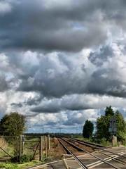 Turves Railway Crossing (saxonfenken) Tags: clouds infinity tracks railway stormy superhero 100 storybook vanishing fen fenland bigmomma gamewinner turves friendlychallenges thechallengefactory thechallengefactorywinner yourock1stplace herowinner pregamewinner 100trans