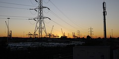 DUSK OVER DOCKS (loujanu22) Tags: bridge autumn sunset england urban blackandwhite sculpture color colour nature docks evening sundown crane dusk pillar railway naturallight panasonic shirley southampton signal millbrook northam shoal railwaytracks pilon gf1