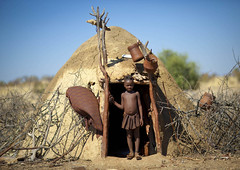 Muhimba tribe house - Angola (Eric Lafforgue) Tags: africa people house tourism home kid child african culture tribal human drought tribes blackpeople tradition tribe ethnic maison enfant namibia cultura tribo himba angola ethnology tribu tourismo nomadic herero