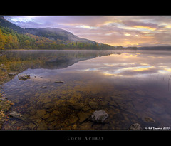 Loch Achray Sunrise (Kit Downey) Tags: autumn trees mist color reflection fall water sunrise dawn scotland october rocks earlymorning explore loch trossachs autumnal hdr stirlingshire realistic lochachray achray scottishlandscape autumnalcolours explored scottishloch tokina1116mmf28 kitdowney canoneos550d canonrebelt2i tiffen77mmpolariserfilter
