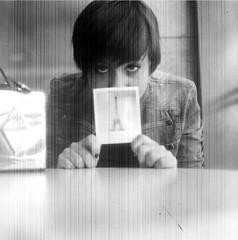Someone has been in Paris (Cereal-Killer 72) Tags: portrait bw 6x6 film polaroid eyes expression explore toureiffel ilfordhp5plus400 yashicamat analogic ltytr1 notexture noposttreatmenthere marlizana aojmetro