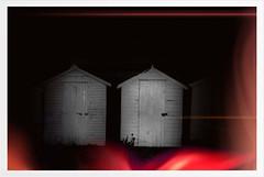 Shining through the darkness (atmoorehead) Tags: november light england bw white black beach apple beer night dark evening nikon exposure noir phone darkness huts devon beachhuts app torchlight 2010 iphone eastdevon pictureshow d40x beerbeach iphone3gs