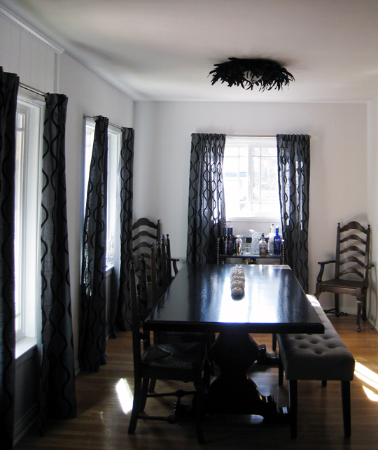 dining room+table with bench+bar+feather light fixture