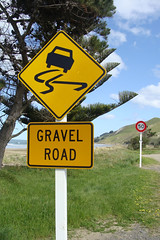 Gravel Road (Home Land & Sea) Tags: newzealand yellow nz roadsign pointshoot sonycybershot gravelroad 50kmh dsch3 centralhawkesbay pourererebeach homelandsea