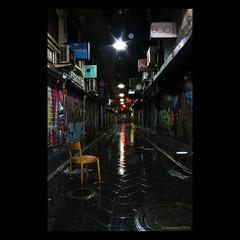 Centre Place, Melbourne (Monochrome Visions) Tags: longexposure light signs art wet rain night reflections puddle dawn graffiti chair alley australia melbourne victoria lane laneway starlight dexodexo douwedijkstra