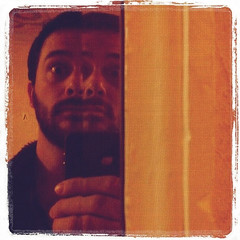 Split Personality (Sion+Anton) Tags: portrait reflection self mirror squareformat weirdo splitpersonality 500x500 redandorange canvastexture iphone4 iphoneography ©antonkawasaki gaybeardedmale instagrampicpicnikcom bevelofmirrorcausessplitpersonality letteraonwallinbackground