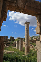 Beneath the Remains (Baker Stass) Tags: city blue sky green birds clouds spring ancient ruins gate day roman stones jordan pillars jerash crowns hkj