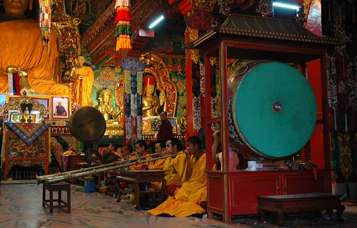 Tibetan Band playing, large drums, Buddha and bodhisattva statues, shrine room, Sakya Lamdre, Boudha, Kathmandu, Nepal by Wonderlane