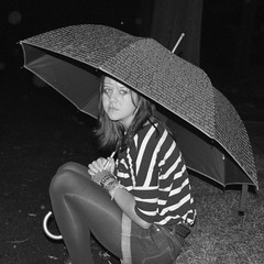 (thegirl-least-likelyto) Tags: street blackandwhite wet girl rain umbrella dark expression stripes letters tights madison shorts bracelets