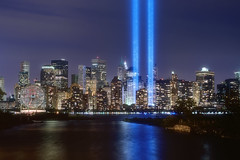 The September 11th Tribute in Lights Memorial, New York City (mudpig) Tags: city nyc newyorkcity longexposure light ny newyork bird skyline night geotagged newjersey memorial jerseycity downtown cityscape worldtradecenter 911 financialdistrict hudsonriver gothamist groundzero hdr tributeinlight 9112001 colgateclock tributeinlights migratorybirds mudpig stevekelley