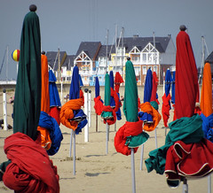 Wrapped Up (Colorado Sands) Tags: france beach french coast seaside frankreich europa europe european frana playa resort explore beaches normandie folded frankrijk umbrellas resorts normandy francia plage praias stranden playas frankrig parasols deauville bassenormandie franaises explored quitasoles strender sandraleidholdt lowernormandy frenchbeaches leidholdt gettysales