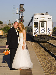 A Happy Couple and Metrolink (K-Szok-Photography) Tags: california people canon outdoors trains socal oc canondslr fullerton canon70200f4l weddingphotography passengerterminal fullertoncalifornia alltrains traindepots adifferentpointofview californiafullerton passengerterminals aphotographersnature kenszok