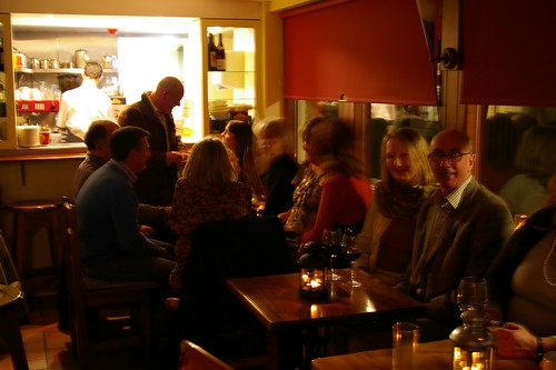 People gathering in The Cottage Café.