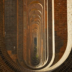 Ouse Valley Viaduct (Duncan George) Tags: uk bridge train buildings sussex vanishingpoint nikon haywardsheath westsussex britain bricks railway arches structure industrialrevolution viaduct archway redbricks victorianarchitecture balcombeviaduct victorianengineering ousevalleyviaduct d700 brightonmainline davidmocatta johnurpethrastrick bestcapturesaoi