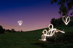 Love At First Light (Light Painting), Kent (flatworldsedge) Tags: longexposure light love grass bench painting hearts star couple stickman earlymorning trails moonlight cuore explored yahoo:yourpictures=love yahoo:yourpictures=happiness yahoo:yourpictures=light