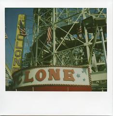 Cloning - Polaroid Style (EssGee Photography™) Tags: travel ny newyork color film sign brooklyn analog vintage polaroid coneyisland humorous fineart humor arcade tourist nostalgia nostalgic rollercoaster spectra cyclone amusements astroland spectrapro