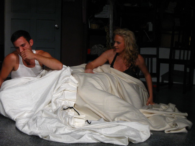 Dan wakes up, shaken, and tells Melissa (Marianne Davis) of his dream.