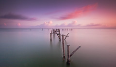 After The Storm (Jeff Engelhardt) Tags: longexposure pink storm water sunrise pier texas purple destruction houston 18thstreet pilings passing ike galvestonbay hurricaneike
