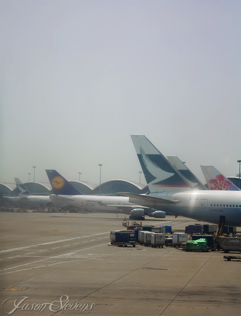 Cathay Pacific Boeing 777-300 'B-HNO' Parked At Hong Kong International With Lufthansa Boeing 747-400 'D-ABVP' Behind and China Airlines 747-400 And 2 More Cathay Pacific 777-300s